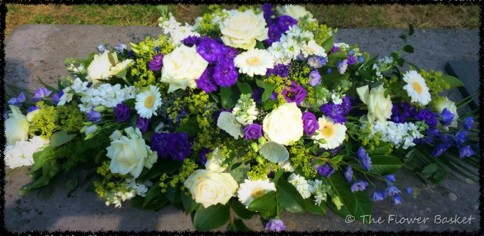 funeral flowers coffintop blue white roses